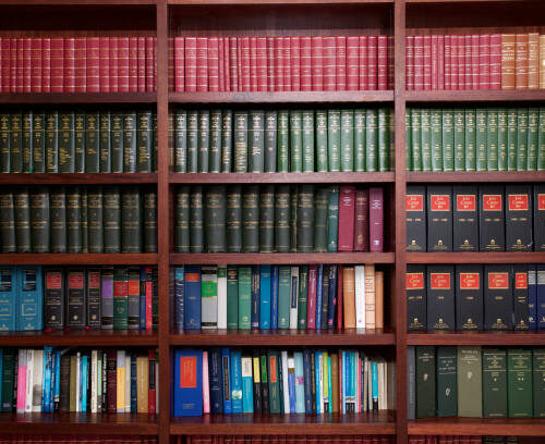 A bookshelf containing volumes of books about Irish Law.